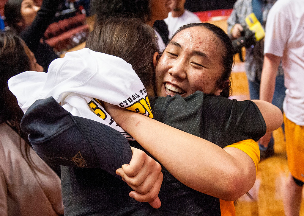 . Long Beach State guard Anna Kim, right, gets a hug as she and her team celebrate winning the Big West Women\'s Tournament against UC Santa Barbara in Anaheim on Saturday, March 11, 2017. (Photo by Paul Rodriguez, Orange County Register/SCNG)