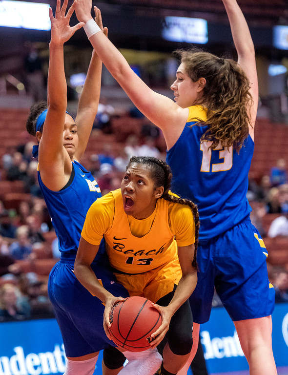 . Long Beach State guard Jewelyn Sawyer, center, tries to move to the basket between UC Santa Barbara guard Sarah Porter, left, and guard Jewelyn Sawyer during the final of the Big West Women\'s Tournament in Anaheim on Saturday, March 11, 2017. (Photo by Paul Rodriguez, Orange County Register/SCNG)