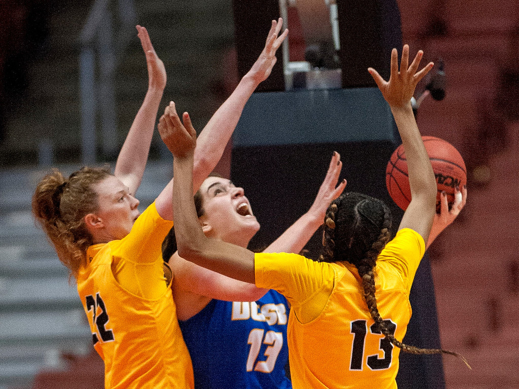 . UC Santa Barbara forward Drew Edelman, center, tries to put up a shot with pressure from Long Beach State forward Madison Montgomery, left, and guard Jewelyn Sawyer, right, during the final of the Big West Women\'s Tournament in Anaheim on Saturday, March 11, 2017. (Photo by Paul Rodriguez, Orange County Register/SCNG)