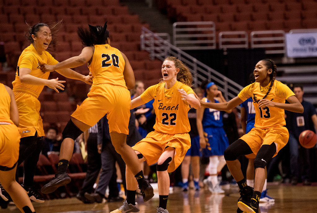 . Long Beach State guard Anna Kim, guard Raven Benton, forward Madison Montgomery and guard Jewelyn Sawyer, from left, celebrate their victory over UC Santa Barbara in the final of the Big West Women\'s Tournament in Anaheim on Saturday, March 11, 2017. (Photo by Paul Rodriguez, Orange County Register/SCNG)