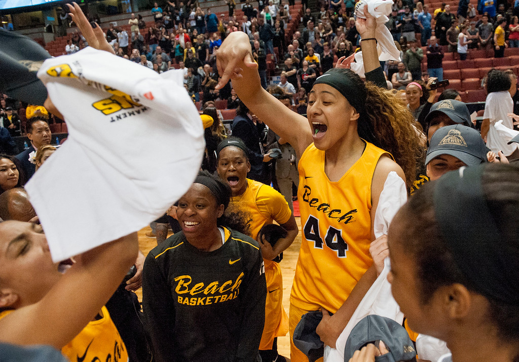 . Long Beach State forward Darshana Ta\'afua, right, celebrates with teammates after the 49ers championship victory over UC Santa Barbara in the final of the Big West Women\'s Tournament in Anaheim on Saturday, March 11, 2017. (Photo by Paul Rodriguez, Orange County Register/SCNG)