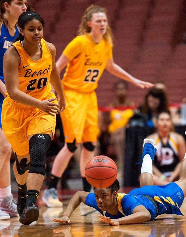 . UC Santa Barbara guard Onome Jemerigbe trips and loses control of the ball as Long Beach State guard Raven Benton, left, moves in to scoop up the ball in the final of the Big West Women\'s Tournament in Anaheim on Saturday, March 11, 2017. (Photo by Paul Rodriguez, Orange County Register/SCNG)