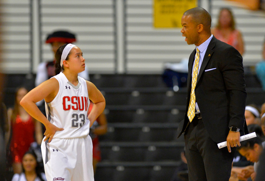. CSUN coach Jason Flowers has a chat with Hayley Tanabe during a break in the action in Long Beach, CA on Wednesday, March 8, 2017. CSUN vs Hawaii in the quarterfinals  of the Big West Women\'s Basketball Tournament at the Walter Pyramid. (Photo by Scott Varley, Daily Breeze/SCNG)