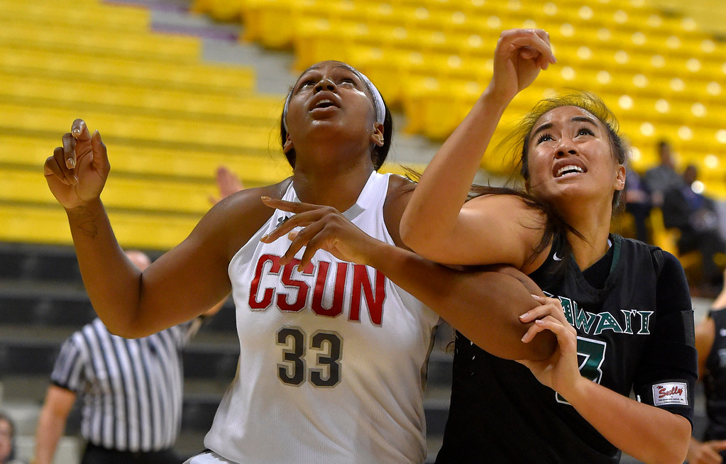 . CSUN�s Channon Fluker battles for a rebound with Hawaii�s Keleah­ Aiko Koloi in Long Beach, CA on Wednesday, March 8, 2017. CSUN vs Hawaii in the quarterfinals  of the Big West Women\'s Basketball Tournament at the Walter Pyramid. (Photo by Scott Varley, Daily Breeze/SCNG)