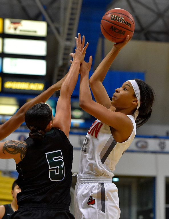 . CSUN�s Eliza Matthews shoots over Hawaii�s Sarah Toeaina in Long Beach, CA on Wednesday, March 8, 2017. CSUN vs Hawaii in the quarterfinals  of the Big West Women\'s Basketball Tournament at the Walter Pyramid. (Photo by Scott Varley, Daily Breeze/SCNG)