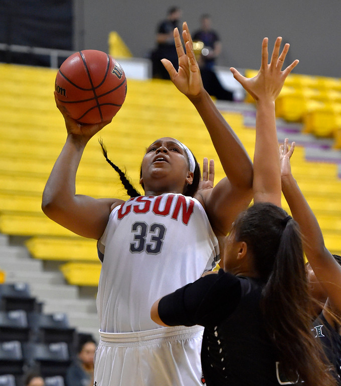 . CSUN�s Channon Fluker puts up 2 of her 39 points against Hawaii in Long Beach, CA on Wednesday, March 8, 2017. CSUN vs Hawaii in the quarterfinals  of the Big West Women\'s Basketball Tournament at the Walter Pyramid. (Photo by Scott Varley, Daily Breeze/SCNG)