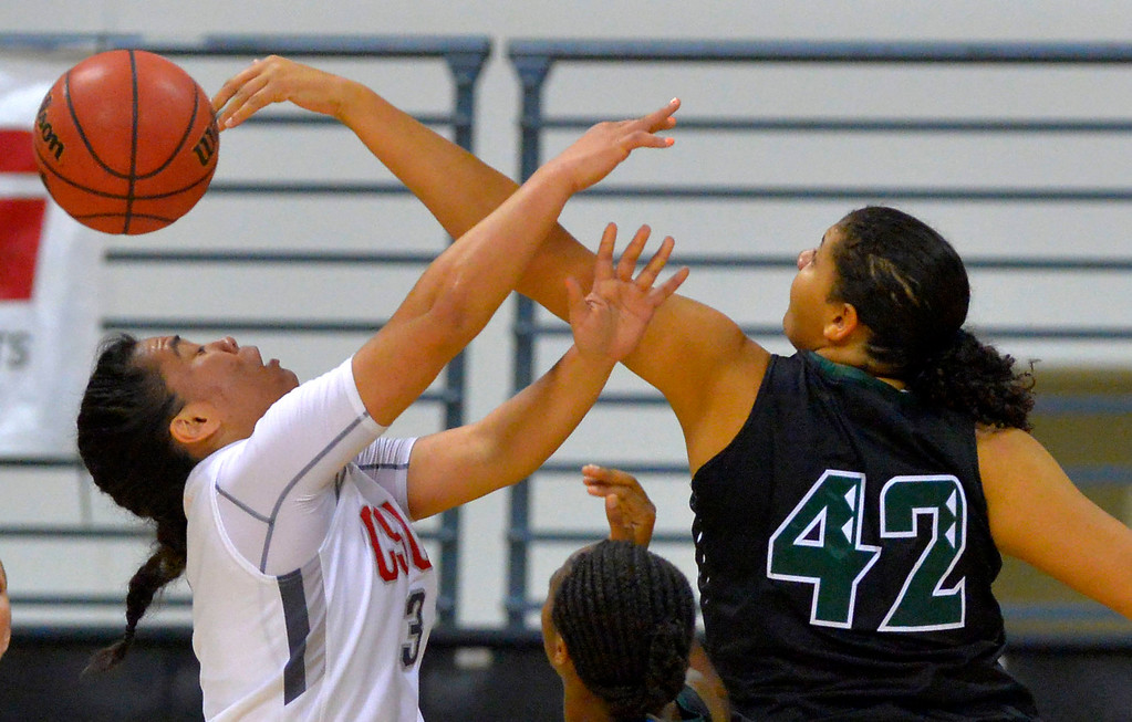 . CSUN�s Serafina Maulupe is fouled on the block by Hawaii�s Adrienne Darden, right, in Long Beach, CA on Wednesday, March 8, 2017. CSUN beat Hawaii 71-64 in the quarterfinals  of the Big West Women\'s Basketball Tournament at the Walter Pyramid. (Photo by Scott Varley, Daily Breeze/SCNG)