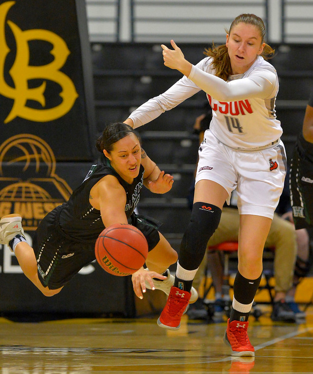 . Hawaii�s Sarah Toeaina, left, gets airborn as she and CSUN�s Emily Cole chase after a loose ball in Long Beach, CA on Wednesday, March 8, 2017. CSUN beat Hawaii 71-64 in the quarterfinals  of the Big West Women\'s Basketball Tournament at the Walter Pyramid. (Photo by Scott Varley, Daily Breeze/SCNG)
