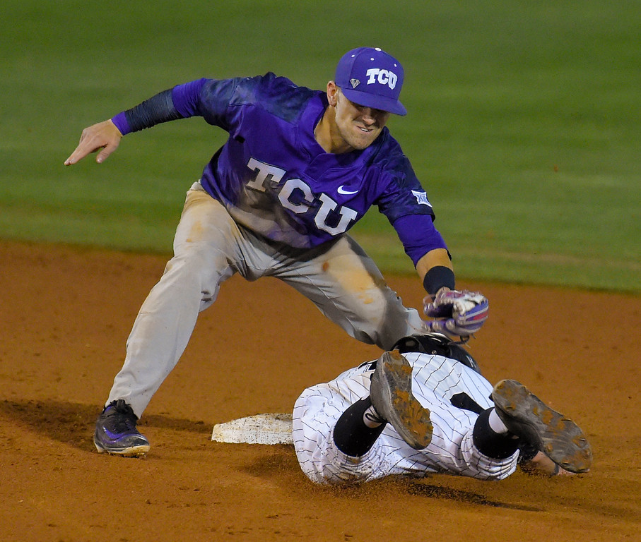 . LBSU�s Jarren Duran is caught stealing and tagged by TCU�s Ryan Merrill in the 5th inning in Long Beach, CA on Tuesday, March 14, 2017. LBSU Dirtbags baseball vs TCU at Blair Field. (Photo by Scott Varley, Press-Telegram/SCNG)