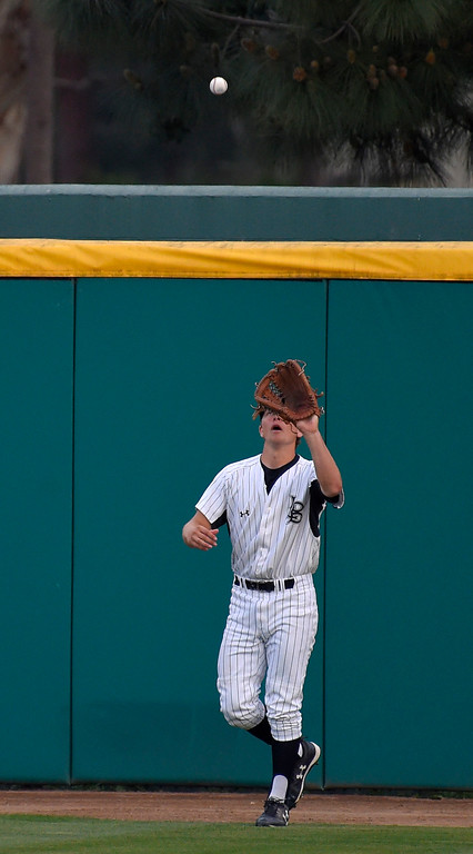. LBSU center fielder Brooks Stotler catches a fly ball at the warning track in Long Beach, CA on Tuesday, March 14, 2017. LBSU Dirtbags baseball vs TCU at Blair Field. (Photo by Scott Varley, Press-Telegram/SCNG)
