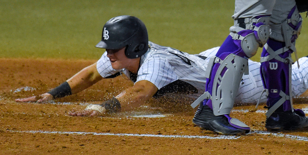 . LBSU�s Luke Rasmussen slides home uncontested on a triple by Lucas Tancas in Long Beach, CA on Tuesday, March 14, 2017. LBSU Dirtbags baseball vs TCU at Blair Field. (Photo by Scott Varley, Press-Telegram/SCNG)