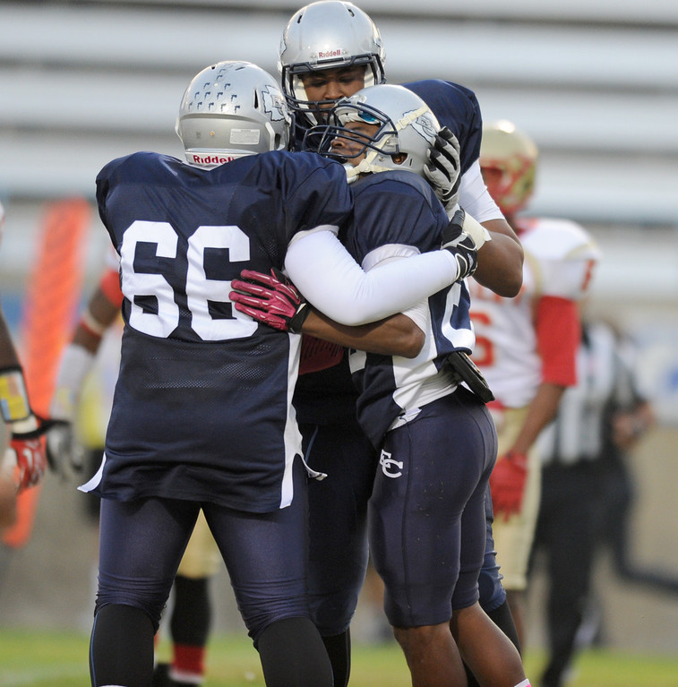 . El Camino\'s Raphael Lawson-Gayle, center, celebrates his touchdown  with Joshua Jasper,left, and Pearce Slater in the North Central Conference football game at Murdock Stadium in Torrance, CA. on Saturday, October 26, 2013. (Photo by Sean Hiller/ Daily Breeze)