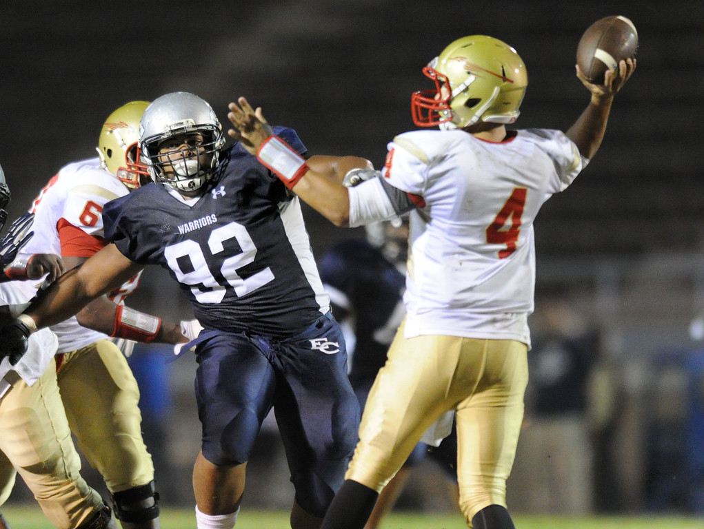 . El Camino\'s Julian Jackson pressures College of the Desert\'s quarterback Dane Tiedeman in the North Central Conference football game at Murdock Stadium in Torrance, CA. on Saturday, October 26, 2013. (Photo by Sean Hiller/ Daily Breeze)