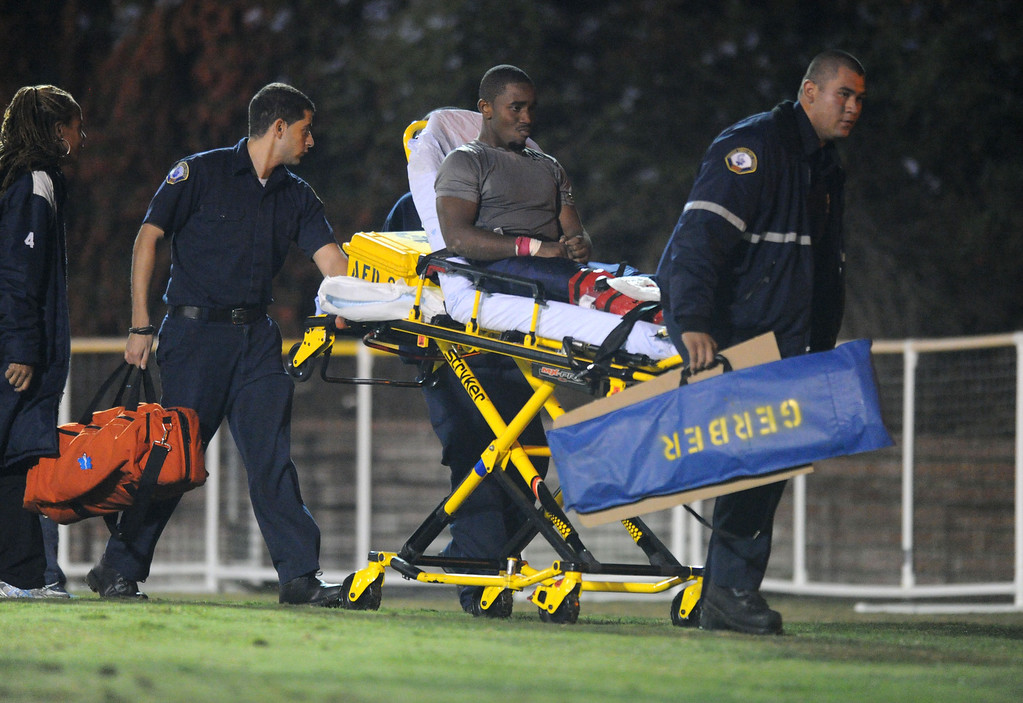 . El Camino\'s Devonte Singleton is transported off the field after suffering an injury in the North Central Conference football game against College of the Desert at Murdock Stadium in Torrance, CA. on Saturday, October 26, 2013. (Photo by Sean Hiller/ Daily Breeze)