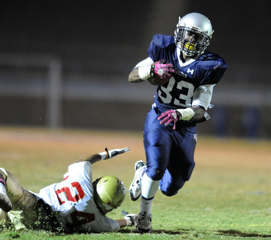 . El Camino\'s Deon Williams on a carry against College of the Desert\'s David Haney in the North Central Conference football game at Murdock Stadium in Torrance, CA. on Saturday, October 26, 2013. (Photo by Sean Hiller/ Daily Breeze)