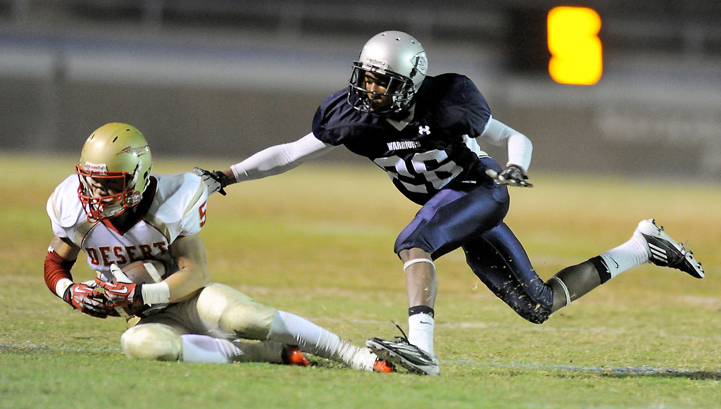. El Camino\'s Xavier Clark tackles College of the Desert\'s Montero DuBose in the North Central Conference football game at Murdock Stadium in Torrance, CA. on Saturday, October 26, 2013. (Photo by Sean Hiller/ Daily Breeze)