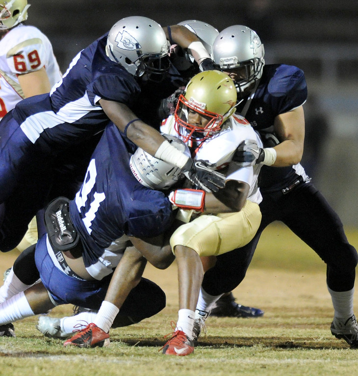 . A host of El Camino defenders take down College of the Desert\'s Toure Boyd in the North Central Conference football game at Murdock Stadium in Torrance, CA. on Saturday, October 26, 2013. (Photo by Sean Hiller/ Daily Breeze)