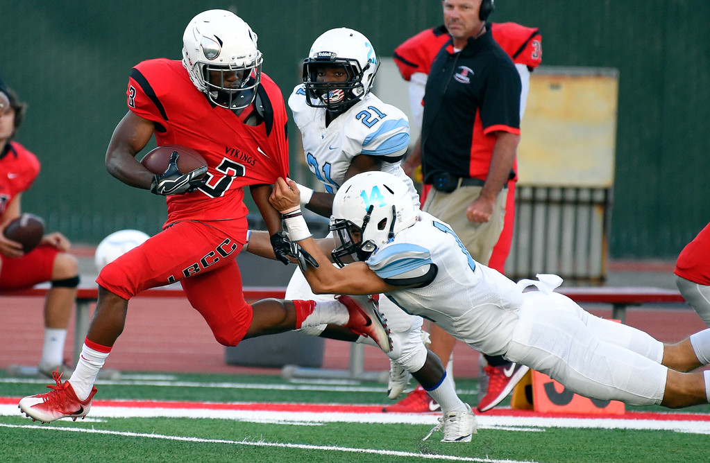 . LBCC\'s Job McGinty brushes off a Moorpark defender en route to a long touchdown in Long Beach on Saturday, September 16, 2017. (Photo by Scott Varley, Press-Telegram/SCNG)