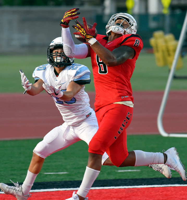. LBCC\'s Cross Poyer intercepts a pass in the end zone intended for  Moorpark\'s Vincent Corso in Long Beach on Saturday, September 16, 2017. (Photo by Scott Varley, Press-Telegram/SCNG)