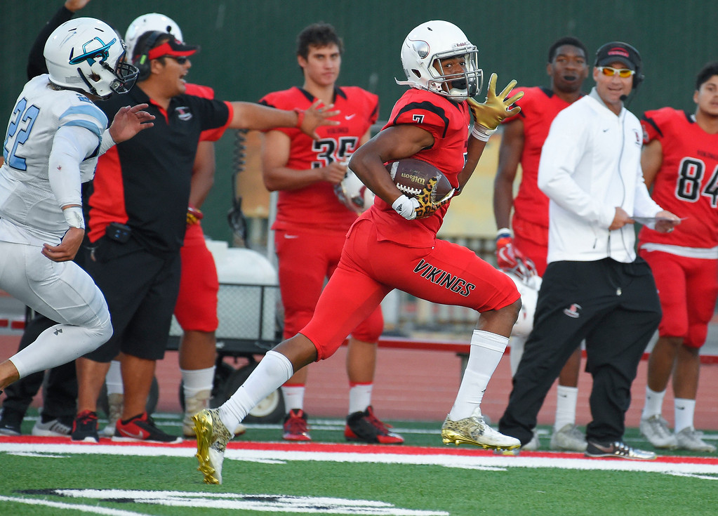 . After picking up a fumble, LBCC\'s Steven Scales evades the last Moorpark tackler to score a 93-yard touchdown in Long Beach on Saturday, September 16, 2017. (Photo by Scott Varley, Press-Telegram/SCNG)
