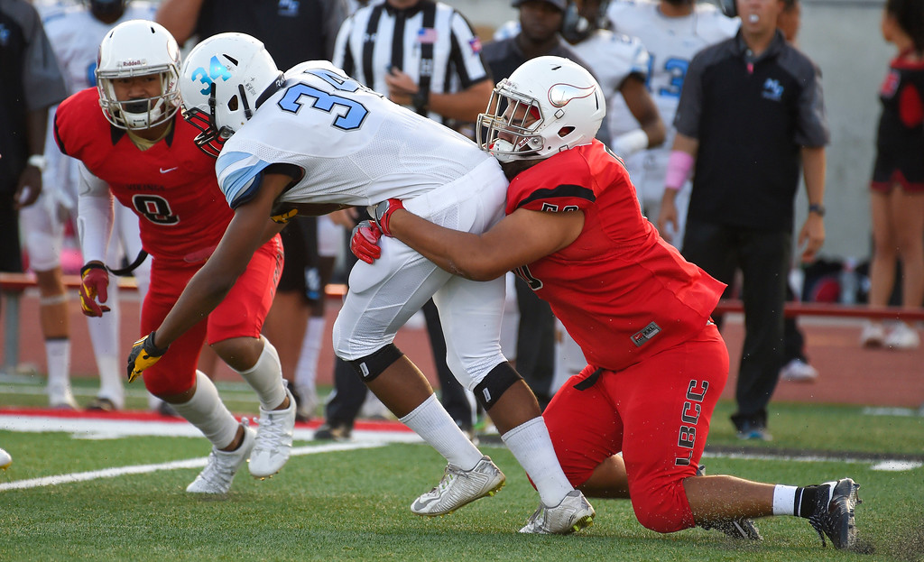 ". LBCC\'s Gilbert ""Bubba\"" Valera tackes Moorpark\'s Tawan Funches for a loss in Long Beach on Saturday, September 16, 2017. (Photo by Scott Varley, Press-Telegram/SCNG)"