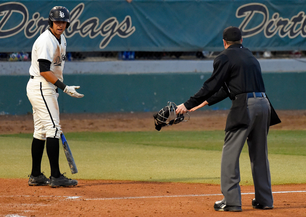 . LBSU�s Ramsey Romano questions a called third strike with home plate umpire Carl Coles in Long Beach on Thursday, April 13, 2017. LBSU vs CSU Northridge baseball. (Photo by Scott Varley, Press-Telegram/SCNG)