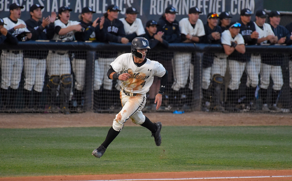 . LBSU�s Jarren Duran scores on a hit by Lucas Tancas in Long Beach on Thursday, April 13, 2017. LBSU vs CSU Northridge baseball. (Photo by Scott Varley, Press-Telegram/SCNG)
