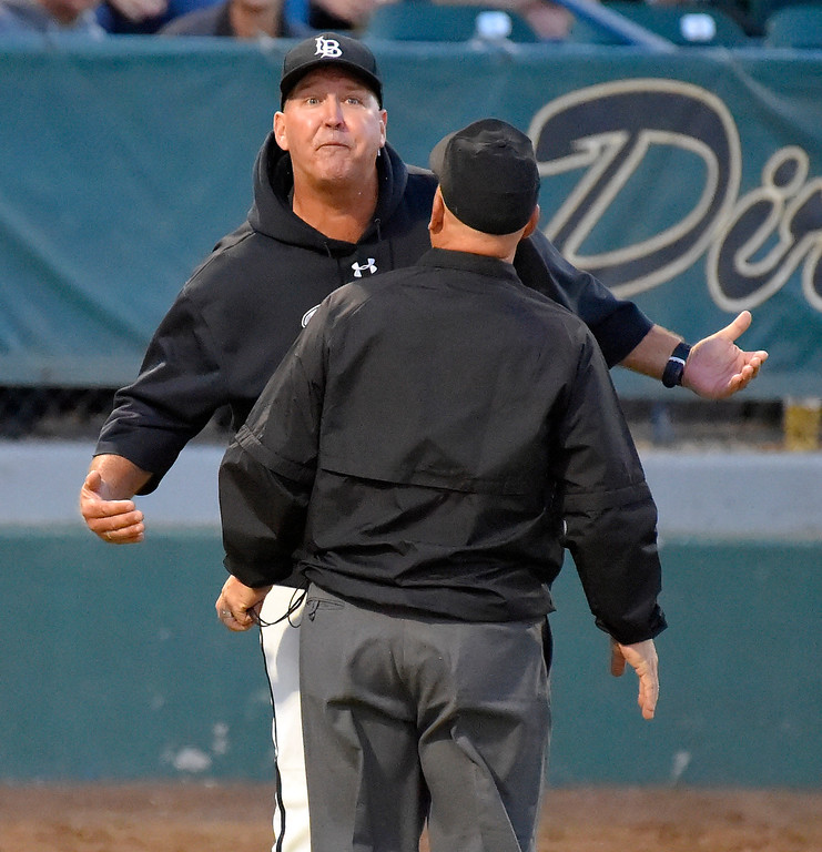 . After being ejected from the game for arguing with the home plate umpire, LBSU coach Troy Buckley is persuaded to leave the field by another ump in Long Beach on Thursday, April 13, 2017. LBSU vs CSU Northridge baseball. (Photo by Scott Varley, Press-Telegram/SCNG)