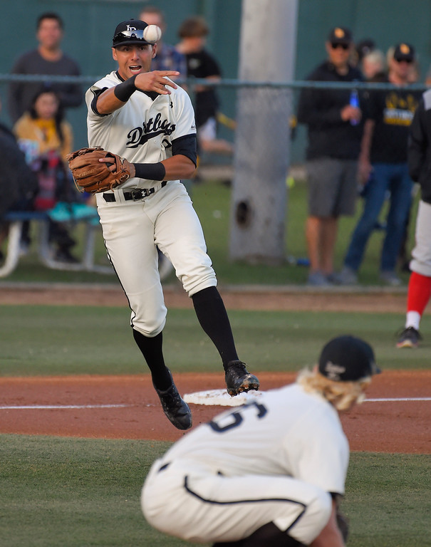 . LBSU pitcher Darren McCaughan ducks so 3rd baseman Ramsey Romano can throw a batter out at first base in Long Beach on Thursday, April 13, 2017. LBSU vs CSU Northridge baseball. (Photo by Scott Varley, Press-Telegram/SCNG)