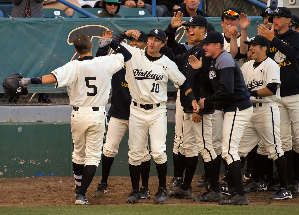. LBSU�s Laine Huffman is congratulated by teammates after hitting a solo homerun in Long Beach on Thursday, April 13, 2017. LBSU vs CSU Northridge baseball. (Photo by Scott Varley, Press-Telegram/SCNG)