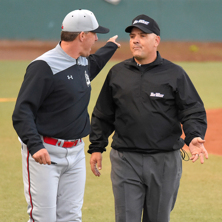 . After being tossed from the game by the home plate umpire, CSUN coach Greg Moore continues to plead his case with another umpire in Long Beach on Thursday, April 13, 2017. LBSU vs CSU Northridge baseball. (Photo by Scott Varley, Press-Telegram/SCNG)