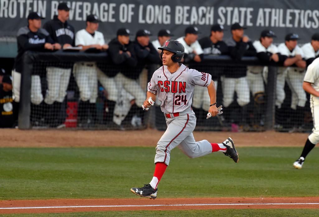 . CSUN�s Alvaro Rubalcaba scores in the 3rd inning in Long Beach on Thursday, April 13, 2017. LBSU vs CSU Northridge baseball. (Photo by Scott Varley, Press-Telegram/SCNG)