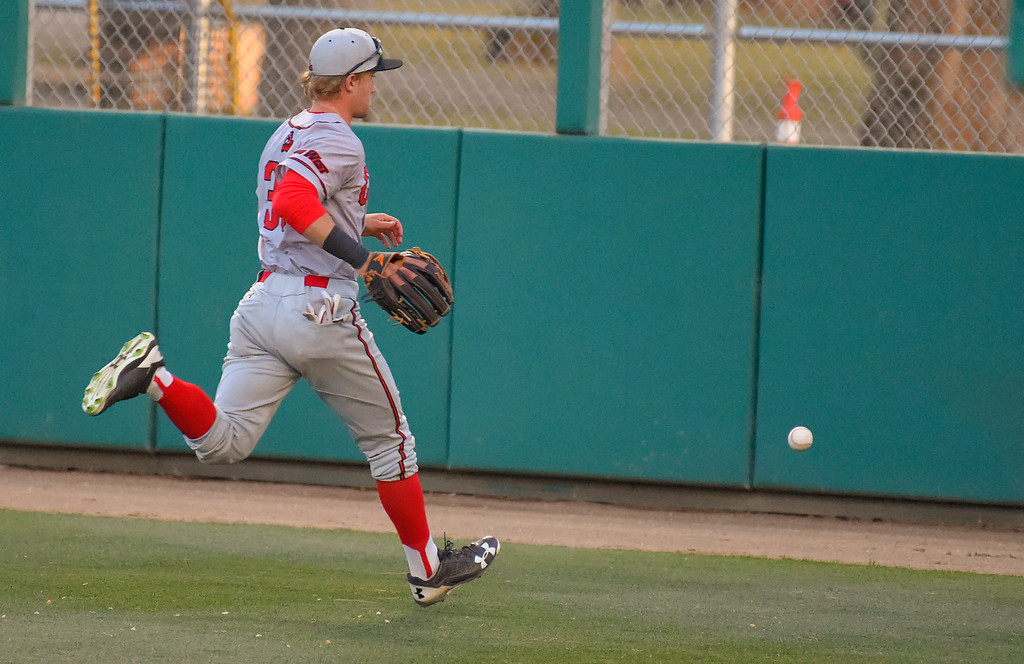 . CSUN right fielder Nick Sablock chases a ball to the outfield wall hit by LBSU�s Lucas Tancas hit for an RBI double in Long Beach on Thursday, April 13, 2017. LBSU vs CSU Northridge baseball. (Photo by Scott Varley, Press-Telegram/SCNG)