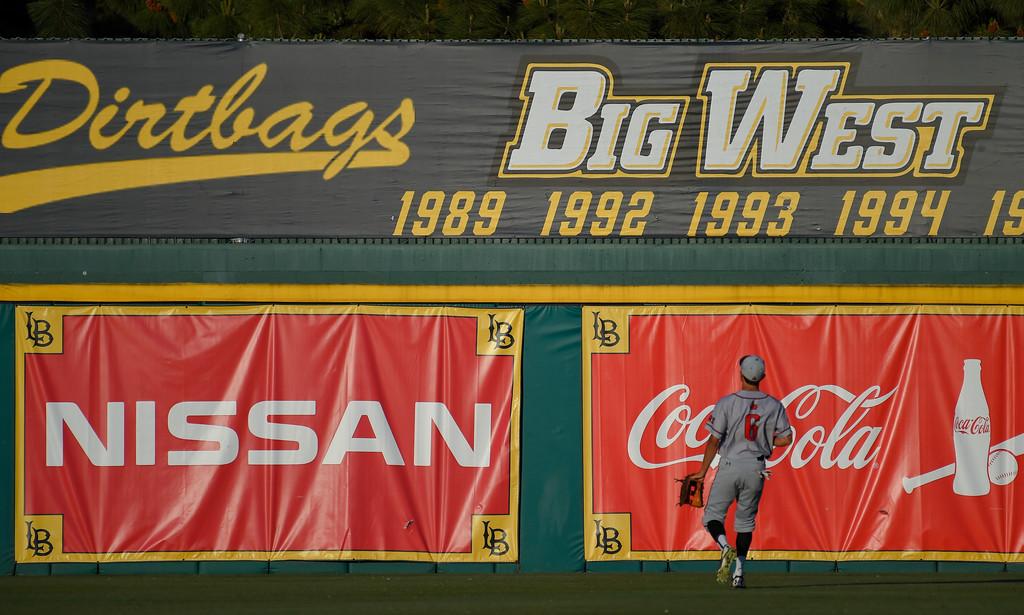 . CSUN�s Elias Oronain can only watch as LBSU�s David Banuelos� 2-run homer sails over the left field wall in Long Beach on Friday, April 14, 2017. LBSU vs CSU Northridge baseball. (Photo by Scott Varley, Press-Telegram/SCNG)