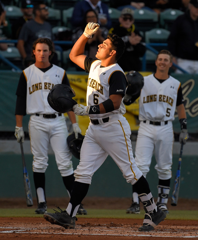 . LBSU�s David Banuelos crosses home plate after hitting a 2-run homer in the 2nd inning in Long Beach on Friday, April 14, 2017. LBSU vs CSU Northridge baseball. (Photo by Scott Varley, Press-Telegram/SCNG)
