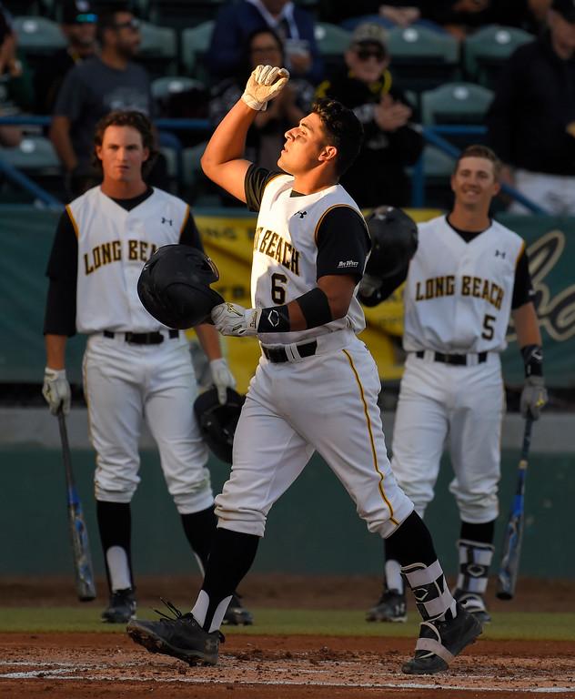 . LBSU�s David Banuelos crosses home plate after hitting a 2-run homer in the 2nd inning in Long Beach on Friday, April 14, 2017. LBSU vs CSU Northridge baseball. (Photo by Scott Varley, Press-Telegram/SCNG)