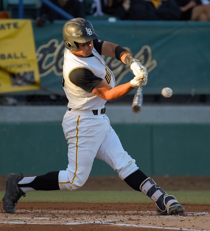 . LBSU�s David Banuelos unleashes on a 2-run homer in the 2nd inning in Long Beach on Friday, April 14, 2017. LBSU vs CSU Northridge baseball. (Photo by Scott Varley, Press-Telegram/SCNG)