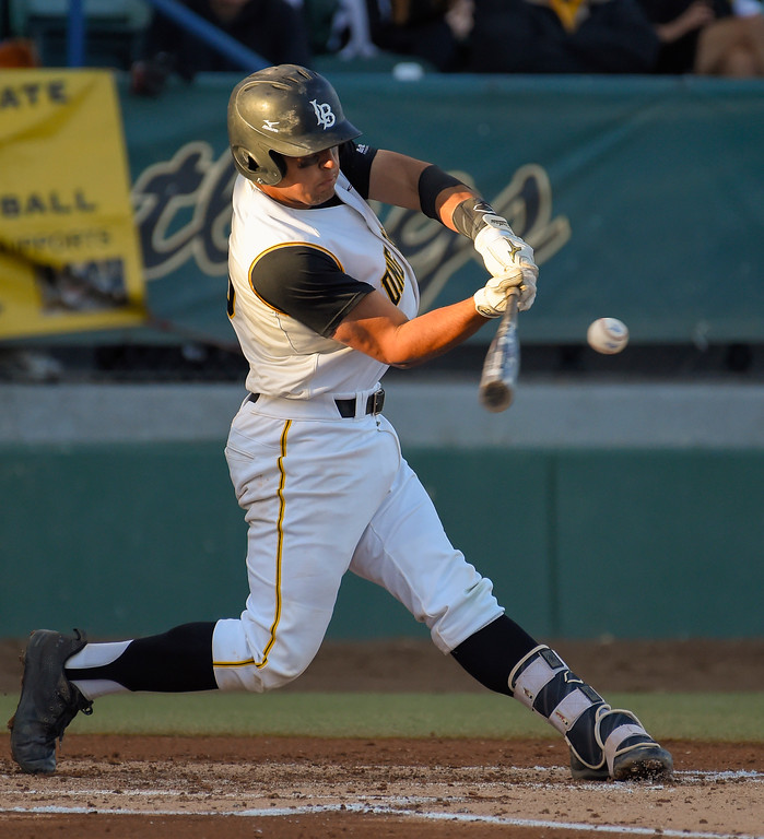 . LBSU�s David Banuelos unleashes on a 2-run homer in the 2nd inning in Long Beach on Friday, April 14, 2017. LBSU vs CSU Northridge baseball. (Photo by Scott Varley, Press-Telegram/SCNG)