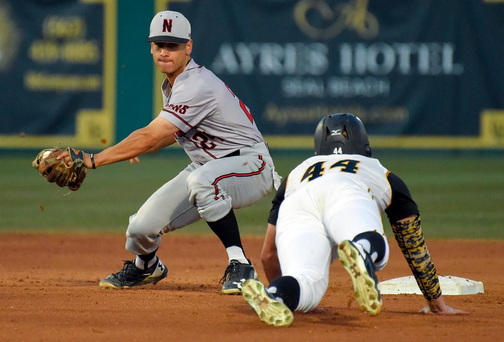 . LBSU�s Luke Rasmussen tries is caught stealing second base by CSUN�s Alvaro Rubalcaba in Long Beach on Friday, April 14, 2017. LBSU vs CSU Northridge baseball. (Photo by Scott Varley, Press-Telegram/SCNG)