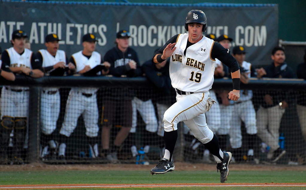 . LBSU�s Lucas Tancas watches right field as he runs in to score from second base on a hit by Garrett Nelson in Long Beach on Friday, April 14, 2017. LBSU vs CSU Northridge baseball. (Photo by Scott Varley, Press-Telegram/SCNG)