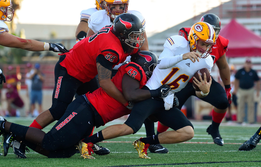 ". Saddleback QB Max Gilliam is sacked by Gilbert ""Bubba\"" Valera and Adebayo Soremekun (42) in Long Beach on Saturday, September 9, 2017. Junior College football - Long Beach City College vs Saddleback. (Photo by Scott Varley, Press-Telegram/SCNG)"