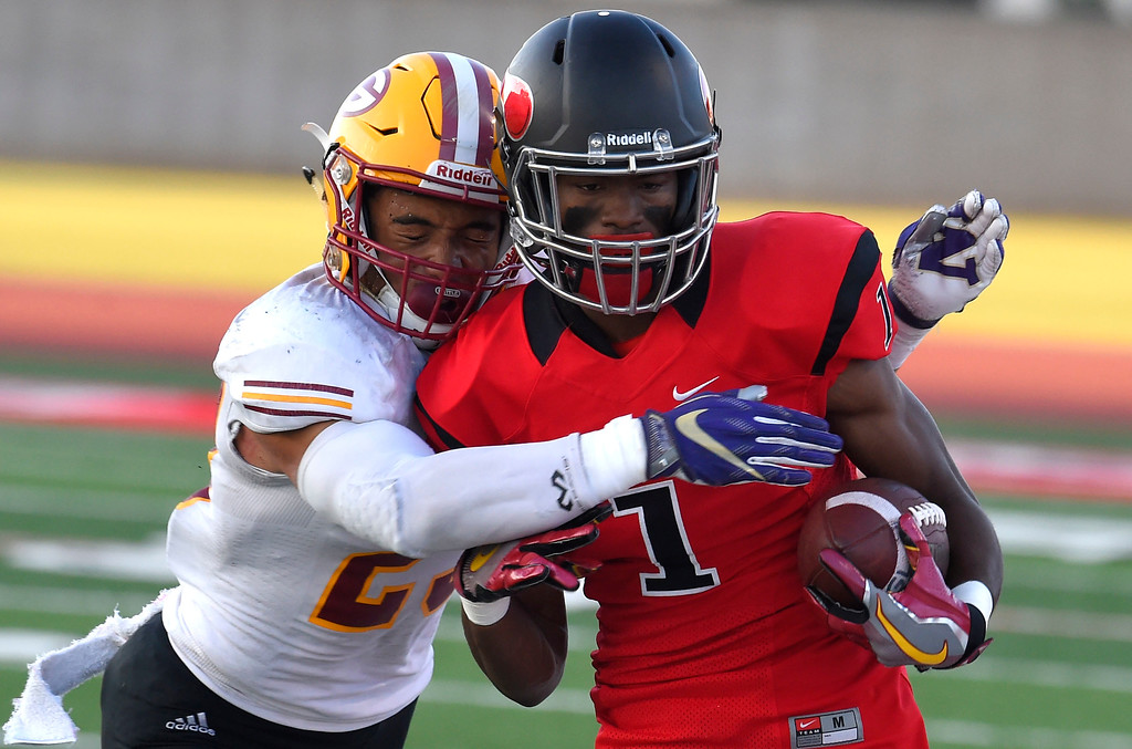 . LBCC receiver Mike Wilson gets stopped by Donte Hamilton after a catch in Long Beach on Saturday, September 9, 2017. Junior College football - Long Beach City College vs Saddleback. (Photo by Scott Varley, Press-Telegram/SCNG)