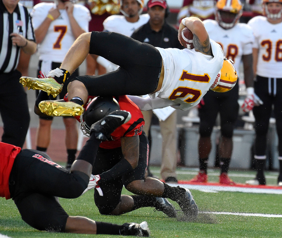 . Saddleback QB Max Gilliam is sent flying after getting hit by LBCC�s Justin Allmond in Long Beach on Saturday, September 9, 2017. Junior College football - Long Beach City College vs Saddleback. (Photo by Scott Varley, Press-Telegram/SCNG)