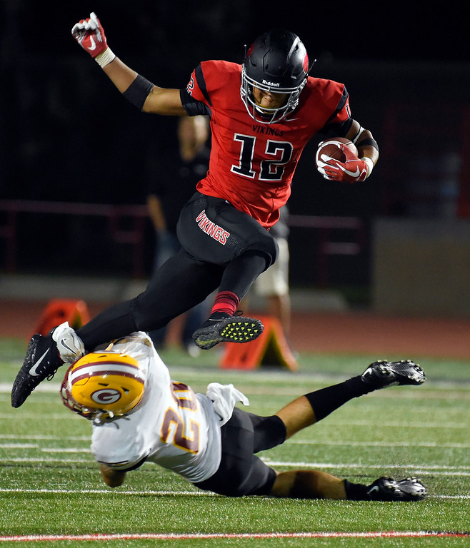 . LBCC�s Elijah Bynum gets tripped up by Ryan Nieman in Long Beach on Saturday, September 9, 2017. Junior College football - Long Beach City College vs Saddleback. Saddleback won 45-35. (Photo by Scott Varley, Press-Telegram/SCNG)