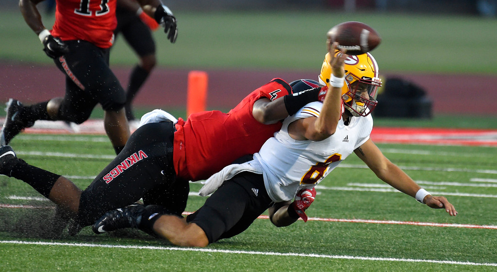 . Saddleback backup QB Cam Humphrey intentionally grounds the ball as he�s tackled by LBCC�s DeAnthony Jones in Long Beach on Saturday, September 9, 2017. Junior College football - Long Beach City College vs Saddleback. (Photo by Scott Varley, Press-Telegram/SCNG)