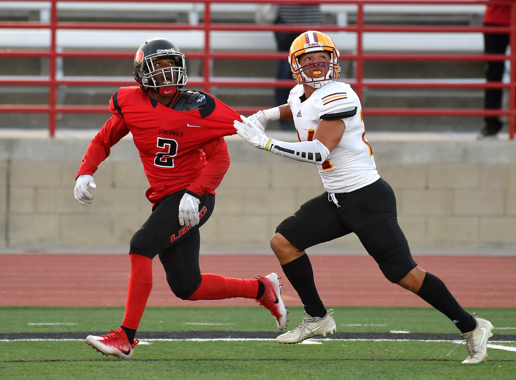 . LBCC receiver Jabari Minix is held by Saddleback�s Jaden Price on a pass to the end zone in Long Beach on Saturday, September 9, 2017. Junior College football - Long Beach City College vs Saddleback. (Photo by Scott Varley, Press-Telegram/SCNG)