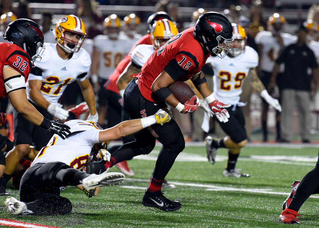 . LBCC�s Elijah Bynum punches his way through the Saddleback line in Long Beach on Saturday, September 9, 2017. Junior College football - Long Beach City College vs Saddleback. Saddleback won 45-35. (Photo by Scott Varley, Press-Telegram/SCNG)