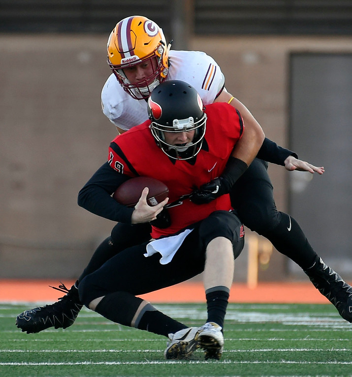 . Under pressure, LBCC QB Grant Lowary is sacked by Saddleback�s Austin Moore in Long Beach on Saturday, September 9, 2017. Junior College football - Long Beach City College vs Saddleback. (Photo by Scott Varley, Press-Telegram/SCNG)