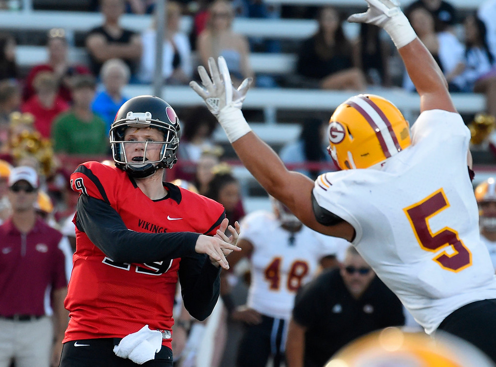 . LBCC QB Grant Lowary passes under pressure in Long Beach on Saturday, September 9, 2017. Junior College football - Long Beach City College vs Saddleback. (Photo by Scott Varley, Press-Telegram/SCNG)