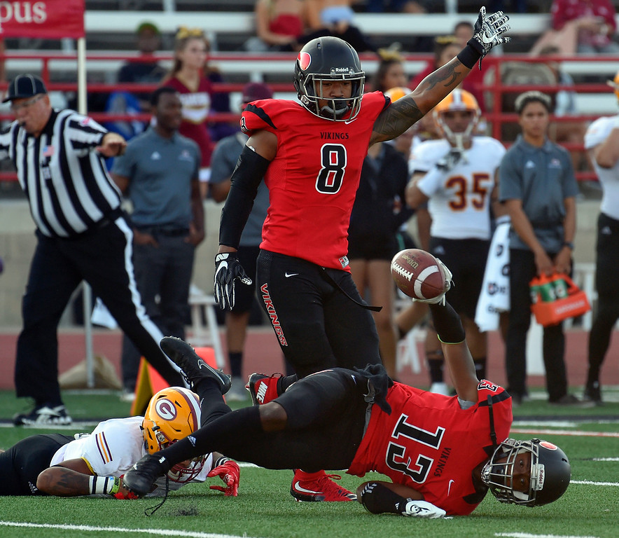 . LBCC��ôs Jeremiah Houston comes up with an interception as Cross Poyer celebrates in Long Beach on Saturday, September 9, 2017. Junior College football - Long Beach City College vs Saddleback. (Photo by Scott Varley, Press-Telegram/SCNG)